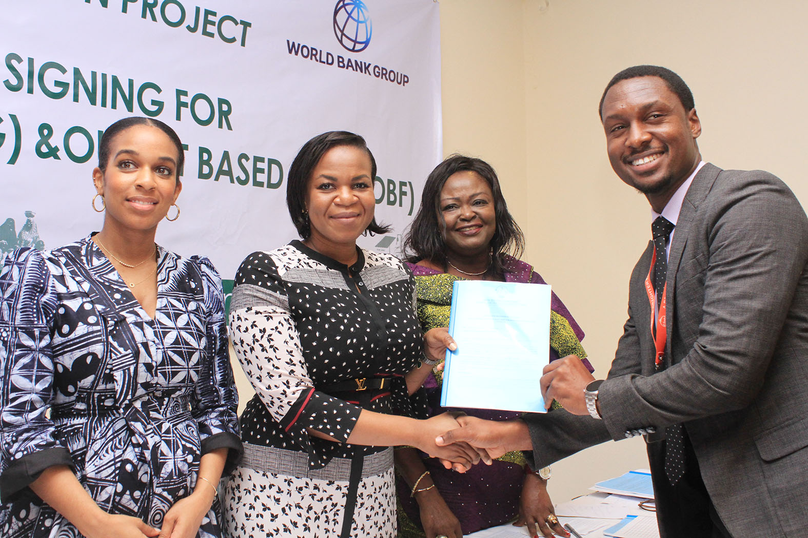L-R, Component Head SHS ,REA, Ifunanya Nwandu-Dozie, MD-CEO Rural Electrification Agency, Damilola Ogunbiyi ,Head Project Management Unit, REA ,Adejoke Odumosu and Marketing Manager Solar by Dlight,Mr Gerald Omani receiving a copy of the Signed Grant Agreement during the event