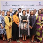 Group Photograph of developer and participant with the MDCEO Rural Electrification Agency Mrs Damilola Ogunbiyi, during the Grant Agreement Signing for