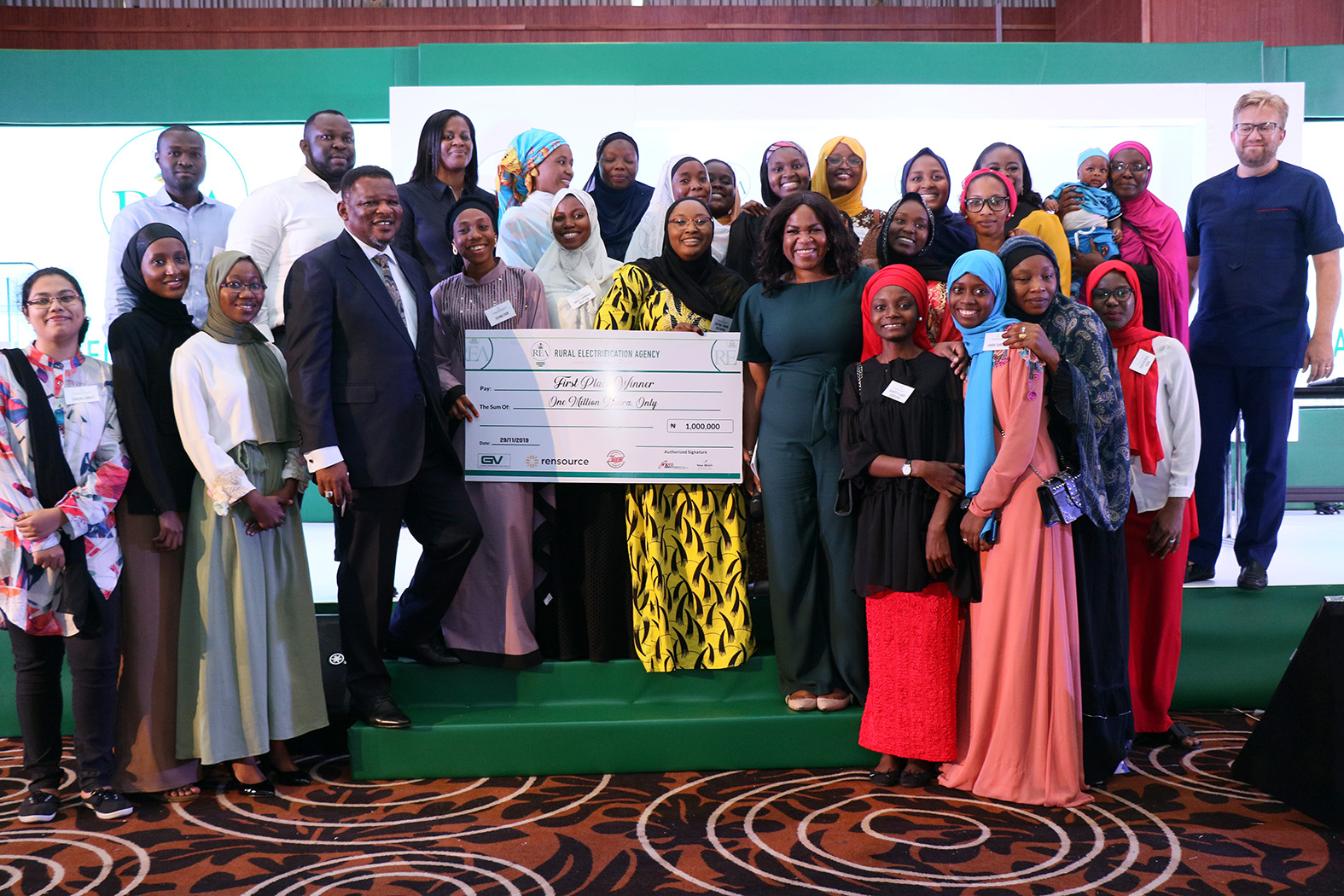 Winner of the Project Shark Tank ,Bayero University Kano Students, Flanked by the Minister of Power State Minister of State Power,Mr Goddy Jedy-Agba,OFR and Managing Director /CEO Rural Electrification Agency,Mrs Damilola Ogunbiyi during the Rural Electrification Energizing Education Programme female Stem Workshop in Lagos